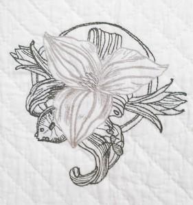 Embroidered Trillium Center logo.